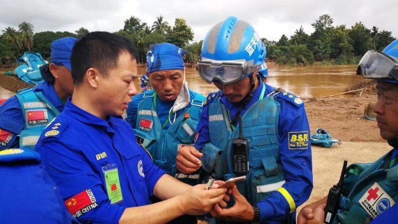 Rescue Forces Analysing Situation In Flooded Area